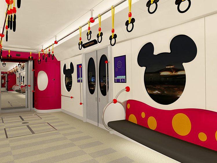 加大的米奇頭像造型窗、米奇手拉環,都是新列車的重點設計。圖/擷取自東京迪士尼度假...