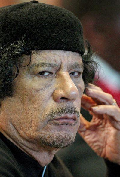 利比亞獨裁者格達費被葬在沙漠一處秘密地點。(法新社)
