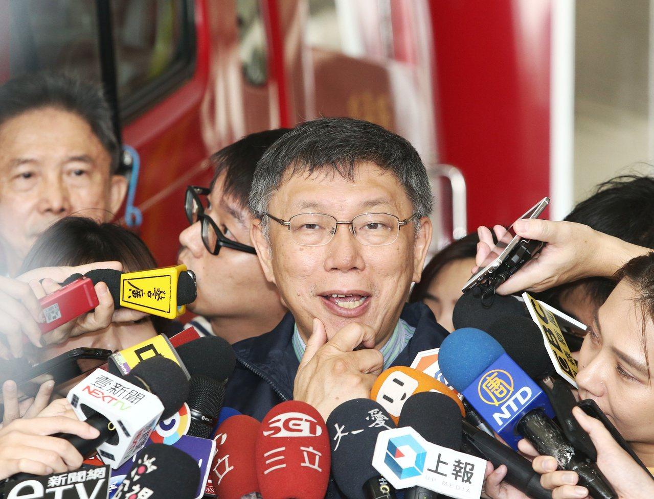 米塔颱風來襲,針對放假決定,台北市長柯文哲表示,放假是北北基討論後的共識。記者曾...