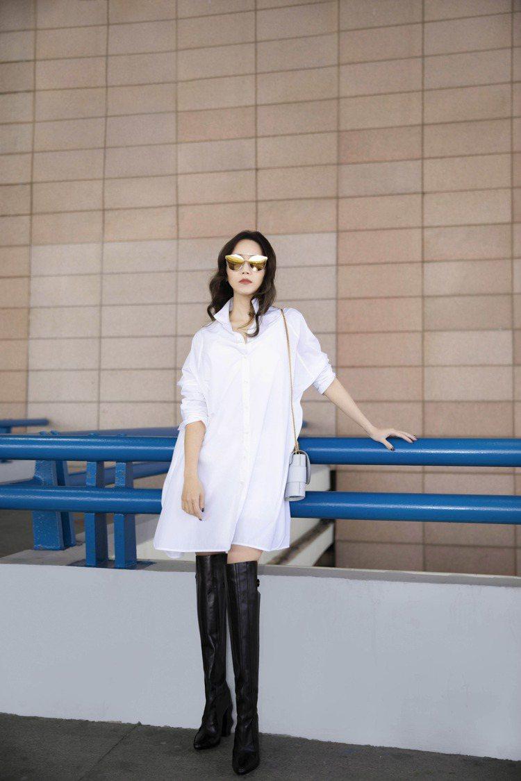 侯佩岑街拍穿白色長版襯衫裙,簡直身高一八○。圖/夏姿提供