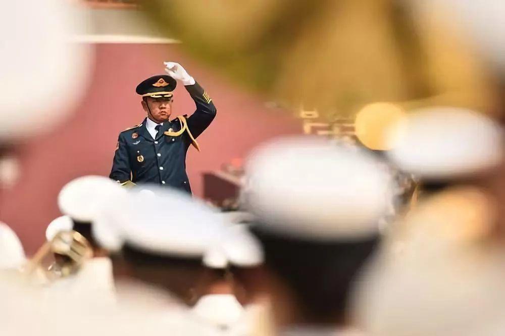 中共建政70周年大會活動,現場演奏共56首樂曲。照片/中新社