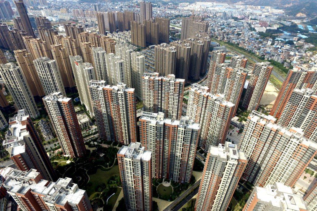 中國國內公司債違約去年激增,今年惡化程度更快,違約者以房地產業居首。 圖/中新社
