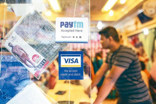 印度正在數位支付發展上積極追趕中國,儘管還有迢迢長路要走,但參與這項計畫的印度國...
