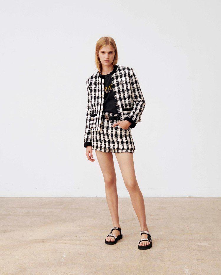 短褲是maje 2020春夏主角,鈕釦千鳥格紋或黑白格紋短褲套裝都是搶眼單品。圖...