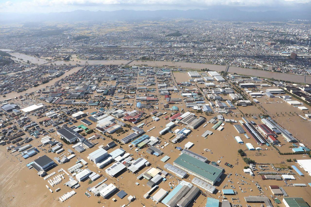哈吉貝颱風造成日本多處水災。(法新社)