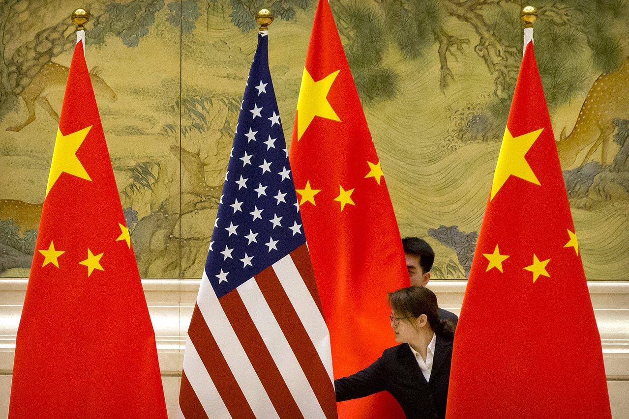 消息人士透露,中國希望最快在月底前與美加強協商,以敲定第一階段協議書面細節。(圖...