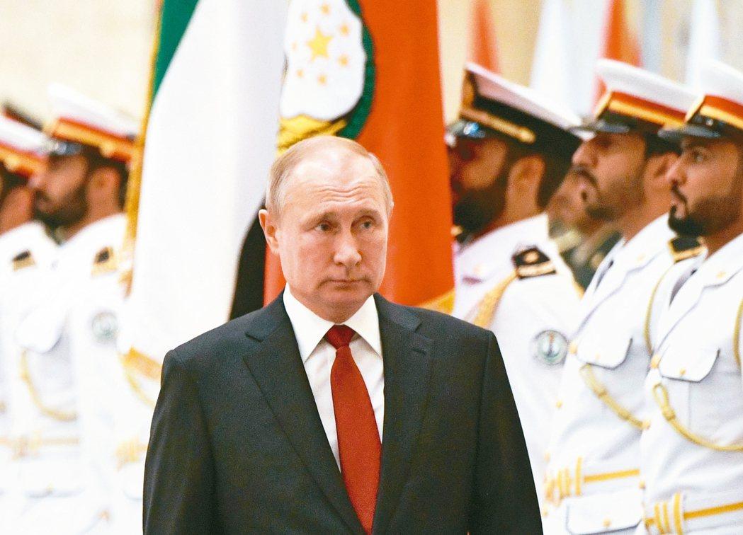 我結緣俄國總統普亭十五日訪問阿拉伯聯合大公國,在阿布達比校閱儀隊。 歐新社