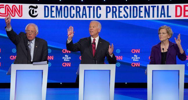 經濟學家克魯曼認為,在15日美國民主黨總統初選辯論會上,參議員桑德斯(左)對自動...