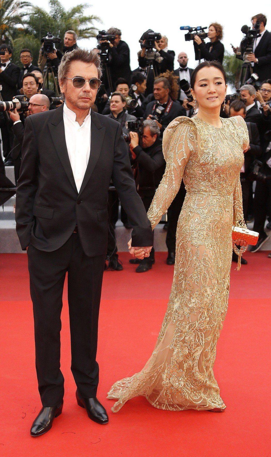 尚米歇爾雅爾與鞏俐在今年坎城影展期間手牽手看首映,已經結婚的消息也隨之公開。圖/...
