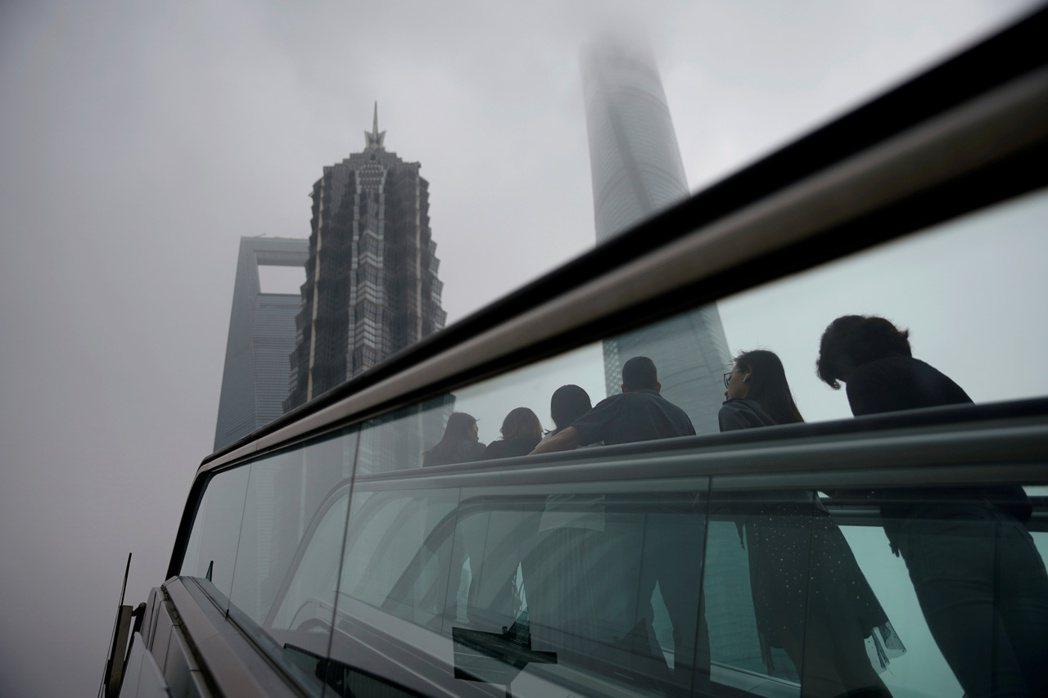 向松祚曾指出,中國經濟下行有國內外原因,當然包括貿易戰,但是最主要原因來自中國國內。 圖/路透社