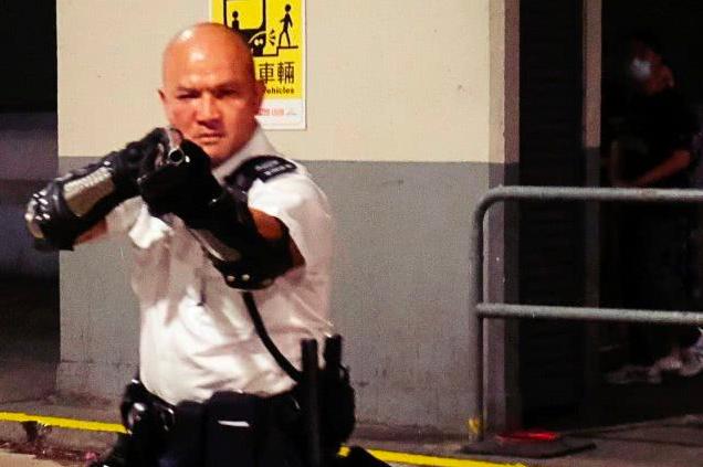 「光頭警長」香港警署警長劉澤基。圖/環球時報