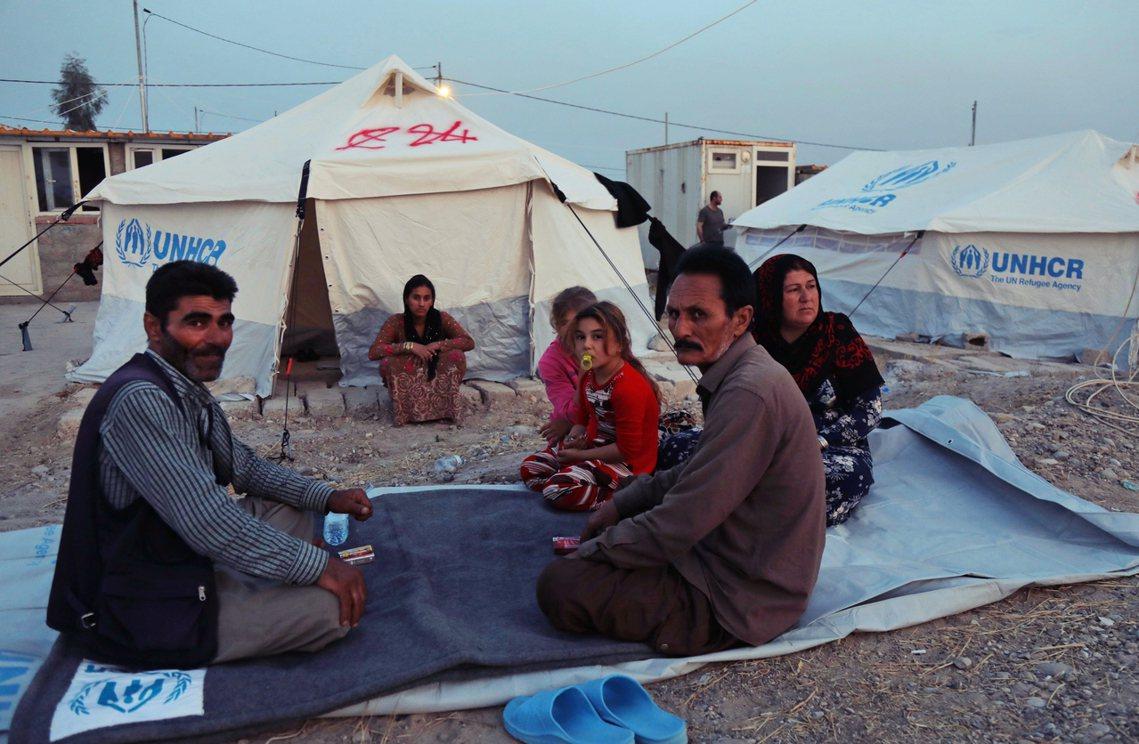 圖為轉往伊拉克的敘利亞庫德人難民。 圖/法新社