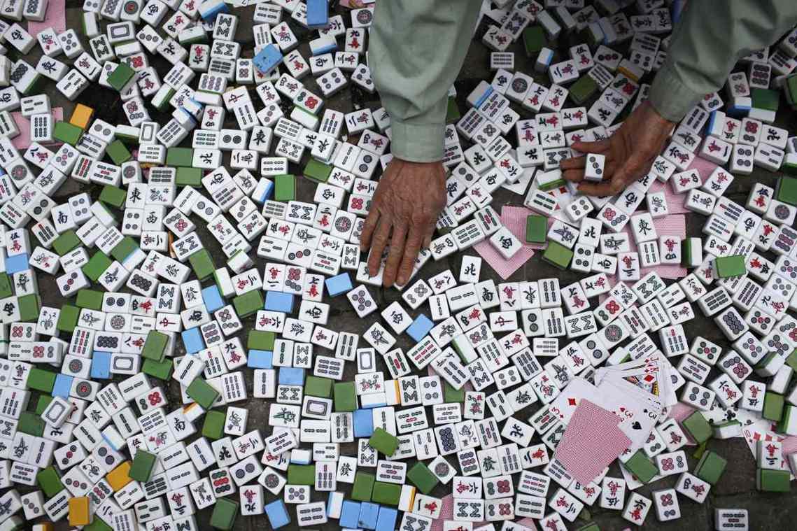 「抓搞賭博的麻將館是沒錯,但現在真正的問題可能是在網路上...」 圖/路透社