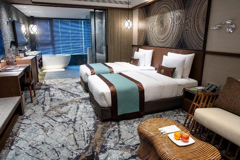 阿樹國際旅店位在台北小巨蛋附近,房間充滿設計感 業者/提供