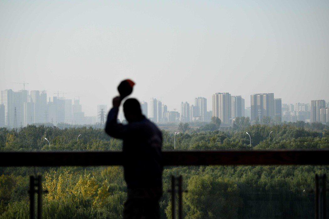 中國國企與大型民企債務違約連番暴雷,已觸發骨牌效應,即將蔓延全中國。 圖/法新社