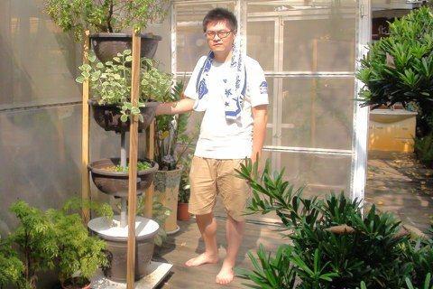 魚菜共生系統現在也開發出層架型,可融入居家庭園景觀。 圖/王昭月攝影