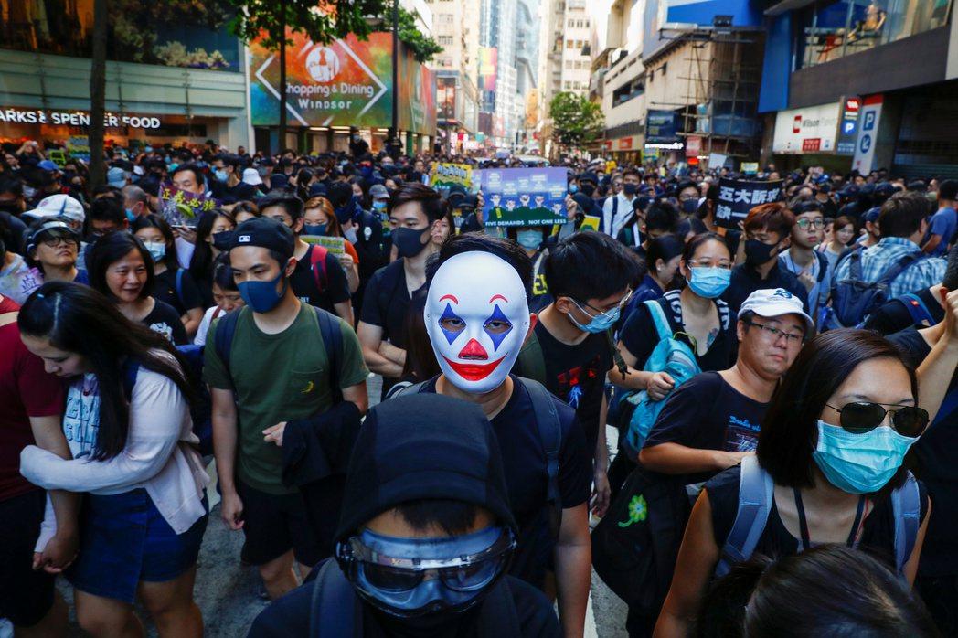 中央的態度,迫使香港人回到妥協與頑抗的抉擇上。 圖/路透社
