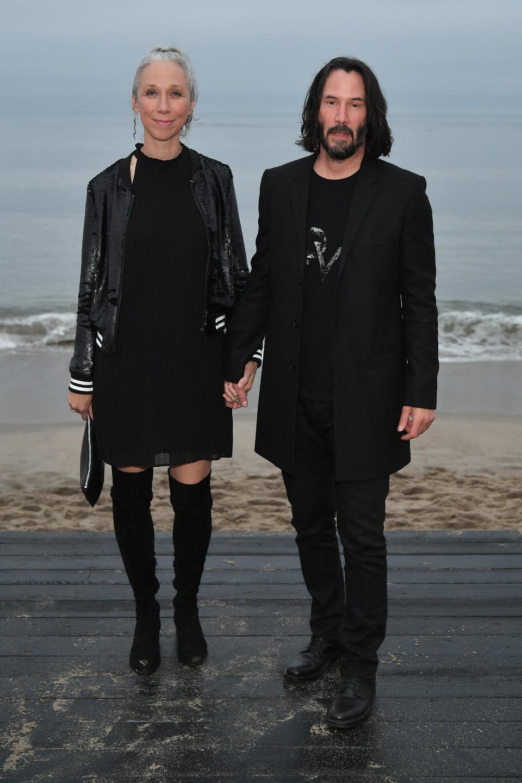 兩人當時早就大方牽手合照,還穿非常登對的情侶裝。圖/摘自forbes.com