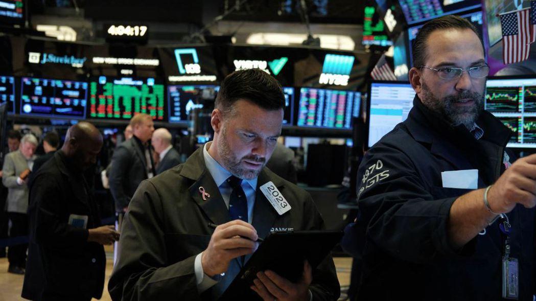 美中貿易協議樂觀展望,激勵道瓊指數和標普500指數周四創收盤新高。  (法新社)
