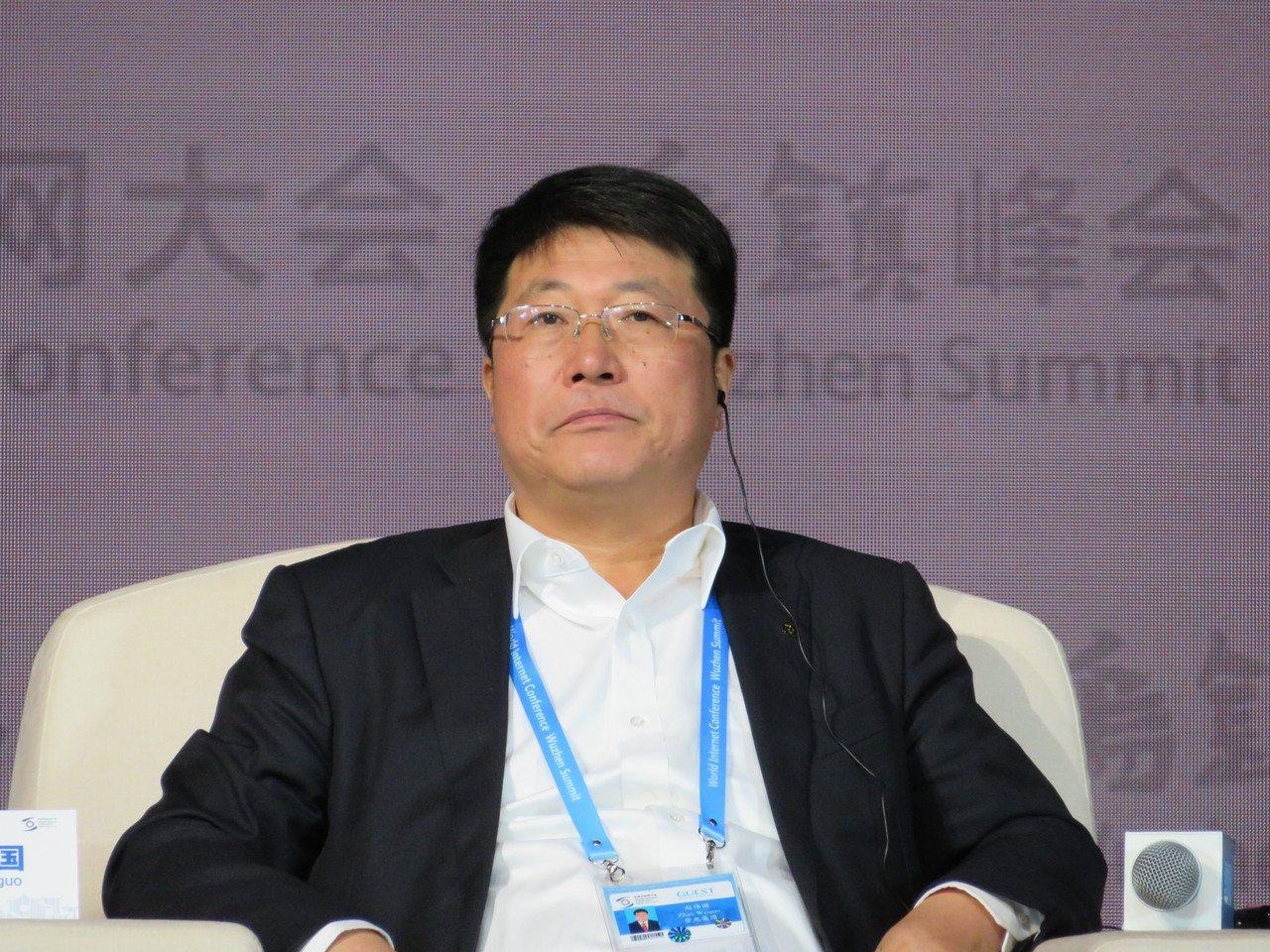 紫光集團董事長趙偉國稱,大陸半導體產業與世界領先國家仍有相當大的差距。(本報系資...
