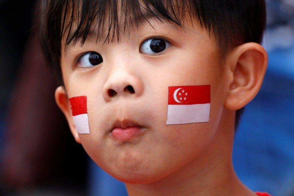 新加坡的教育政策將「母語」當成義務教育的科目,而他們對母語的定義是一個人所屬種族的那個語言,也就是民族的語言。 圖/路透社
