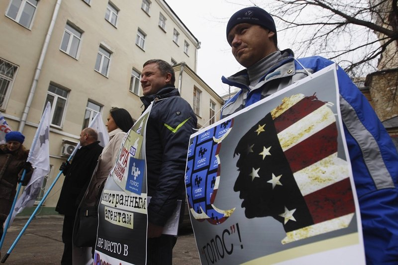 俄羅斯政府認為Golos組織收了美國的錢,是外國勢力干涉俄羅斯政治。圖為2013年示威者於莫斯科抗議修法。 圖/路透社