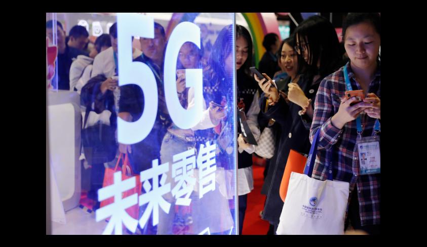 2020年將迎來5G手機換機潮,5G手機價格將迅速下降。圖/中新社