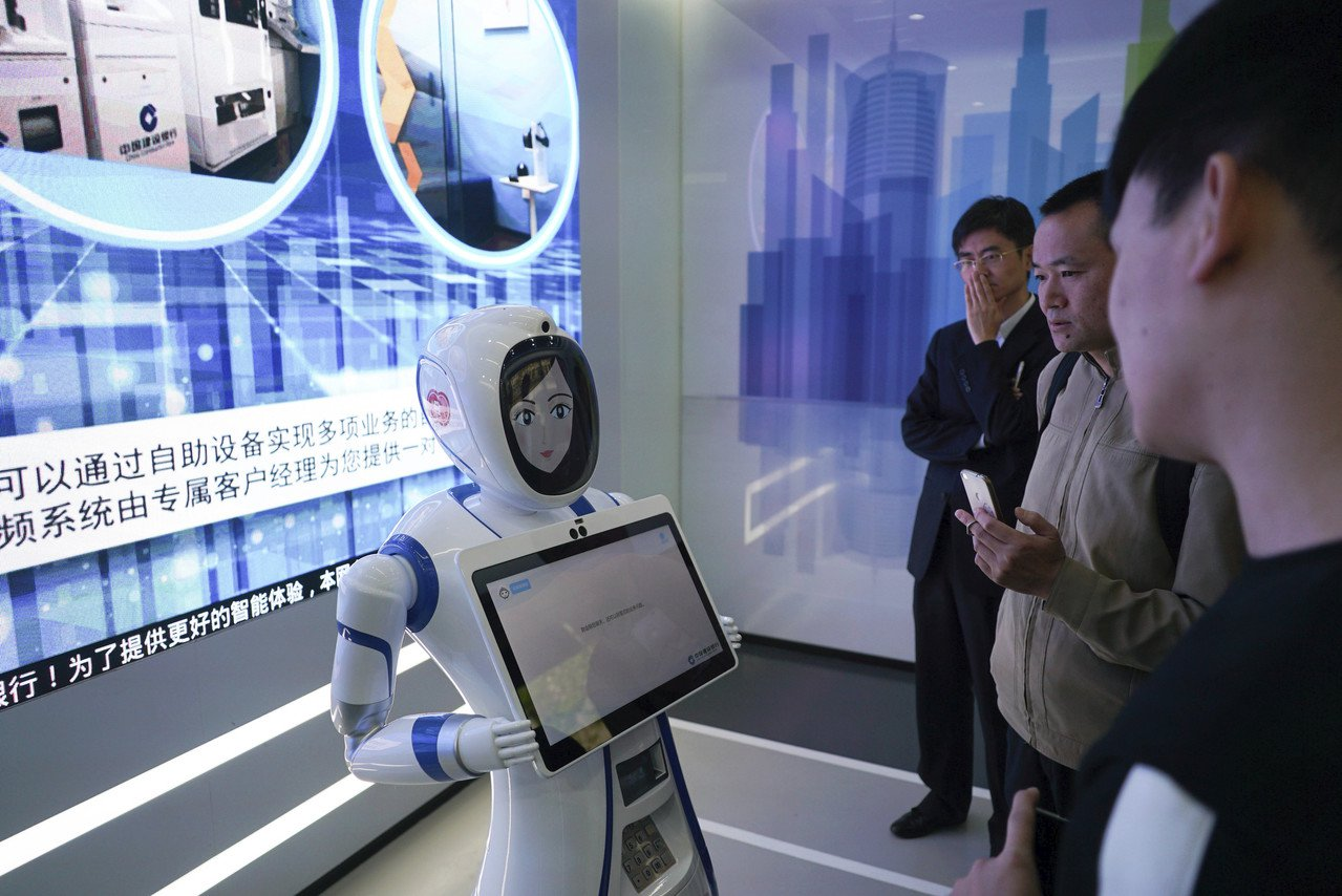 中國建設銀行2018年在上海開設第一家全自動無人銀行。 美聯社