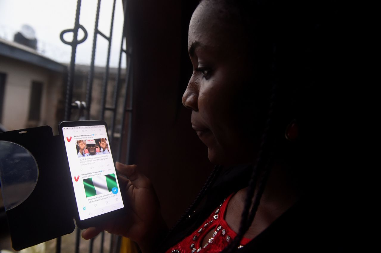 奈及利亞詐騙猖獗,一名囚犯甚至能在獄中遙控同夥行使詐騙,圖為示意照。(法新社)