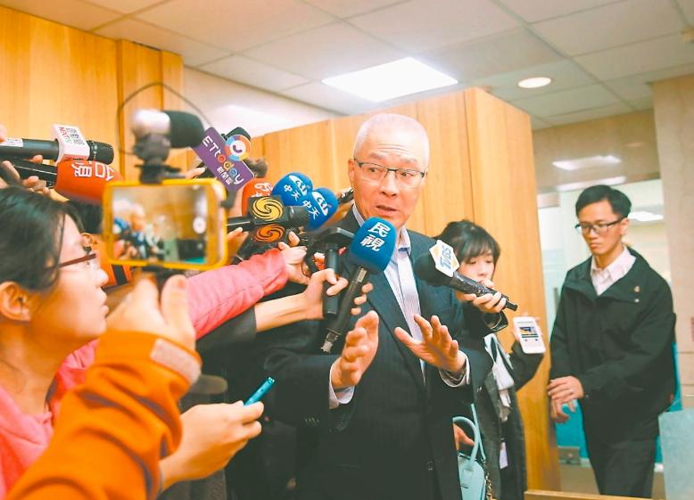 國民黨主席吳敦義(中)。 圖/聯合報系資料照片