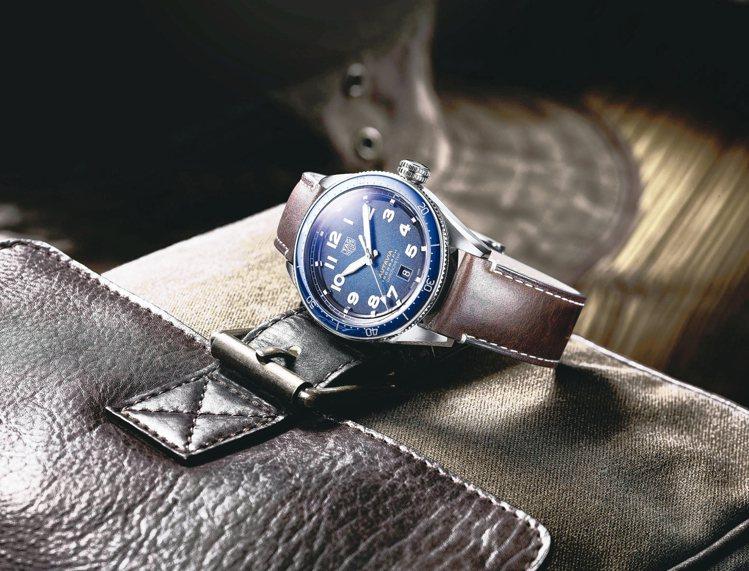 泰格豪雅Autavia系列腕表,不鏽鋼表殼搭配藍色陶瓷表圈,搭載碳游絲機芯, ...