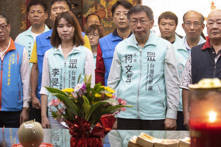 民進黨主席卓榮泰指李旻蔚出來參選,是被台北市長柯文哲(右)煽動、拱她出來選。李旻蔚(左)表示,舊政治有許多的無可奈何,她不計較。圖/報系資料照片