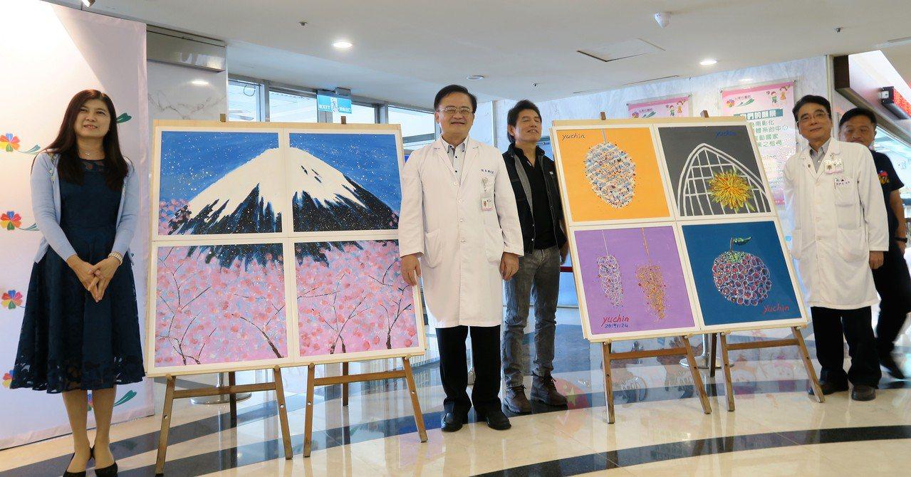 彰化醫院邀請來40多名畫家義務彩繪天花板,花了半年的時間終於在天花板開展。記者凌...