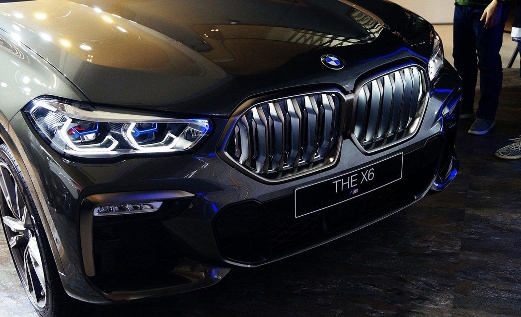 LED飾光水箱護罩加上湛藍色X字樣雷射頭燈,讓X6車頭更佳炫彩奪目。 記者趙駿宏...