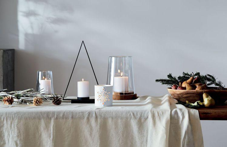 燭光燈飾與冬季應景植物,可為耶誕餐桌增添應景溫暖氛圍。圖/Crate and B...