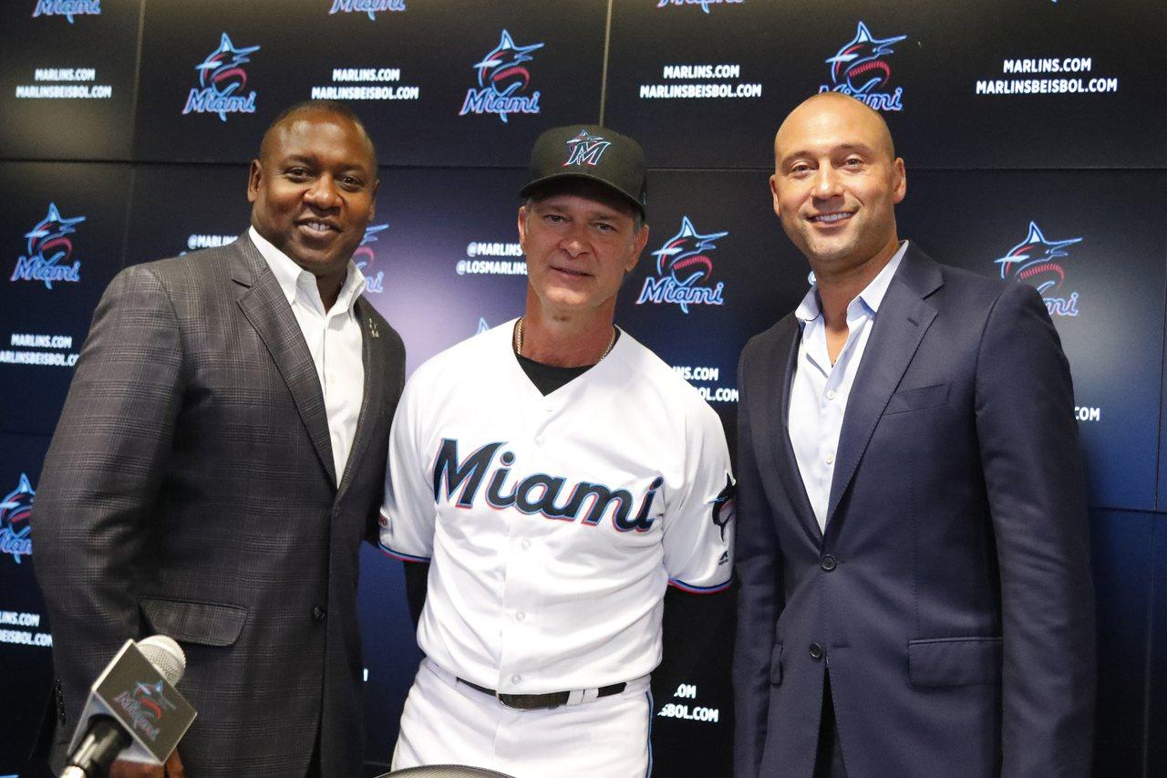 邁阿密前鋒報指出馬林魚該開始在自由球員市場上當買家了,不知道基特(右)與教頭馬丁...