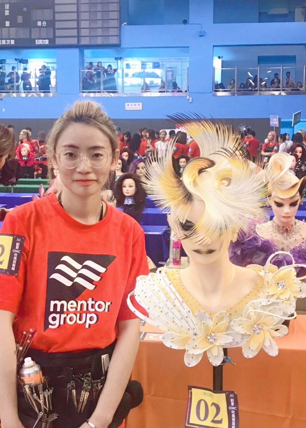 弘光科大美髮系學生黃若瑜勇奪美髮賽冠軍。圖/弘光科技大學提供