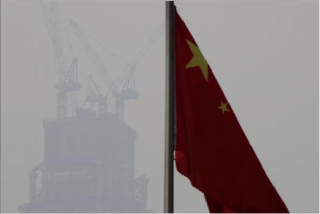 中共工信部運行監測協調局副巡視員解三明預料,中國明年GDP增速有可能回落至6%左右。(路透社資料照片)