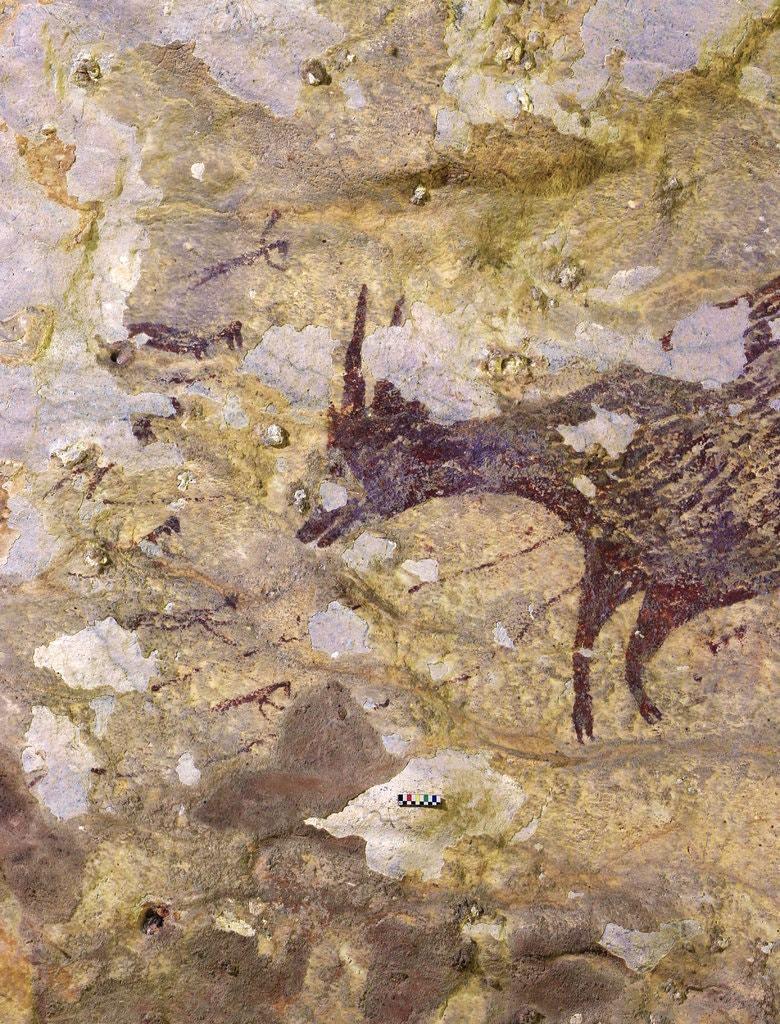 考古學家在印尼蘇拉威西一個洞穴發現4萬4000年前的壁畫。(翻攝紐約時報)