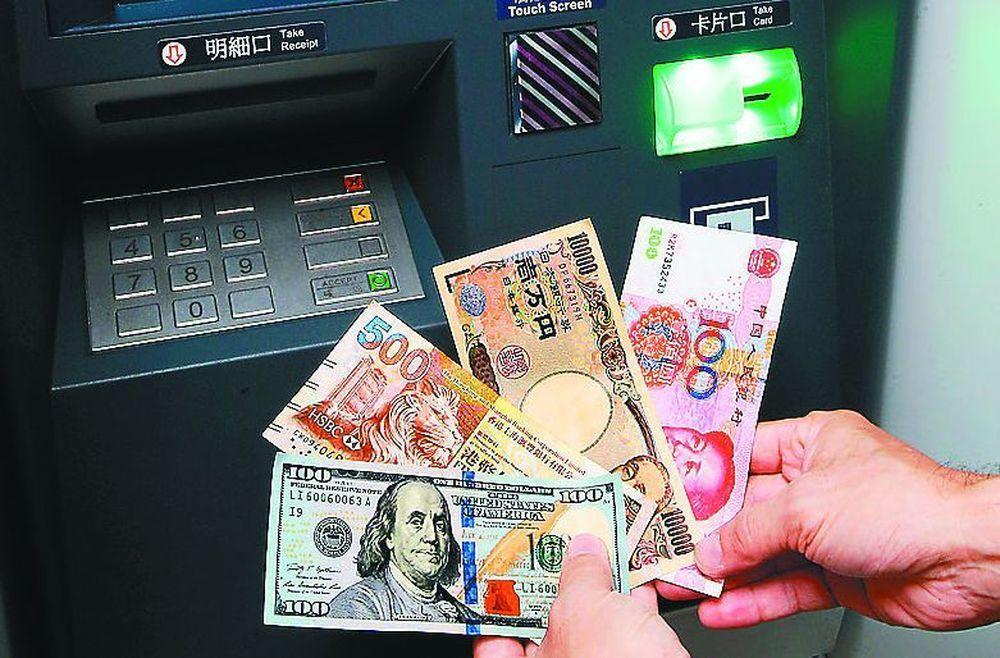 最近要去日本的民眾,可先換一部分存入外幣帳戶內,之後從銀行的外幣ATM領取。圖/...