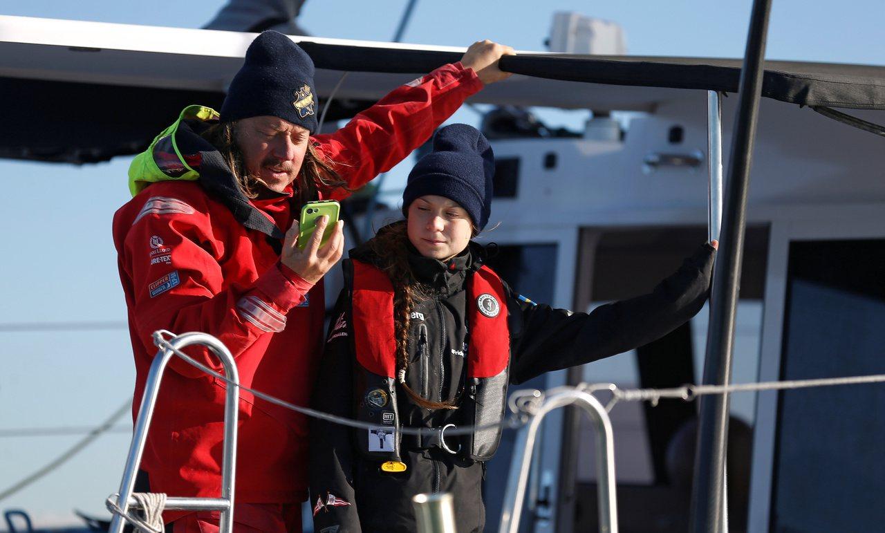 瑞典環保少女童貝里(右)和父親斯萬特(左)。(路透)
