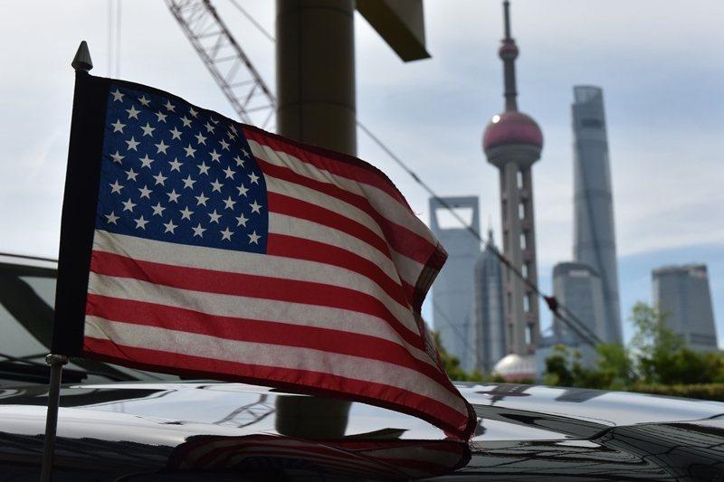 美中關係正常化以來,商業利益長期掩蓋了兩國制度根本上的矛盾。 圖/法新社