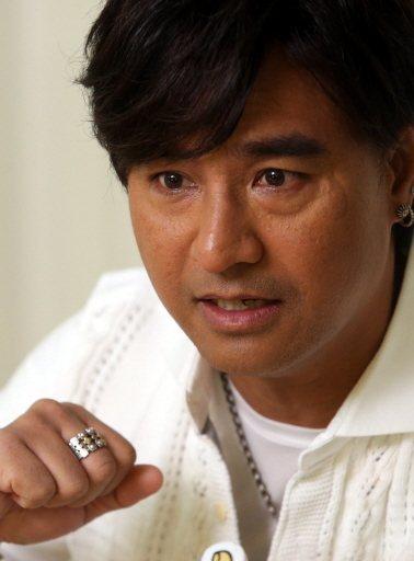 尤秋興50歲才新婚,生子自虧「游很慢」。記者林俊良/攝影