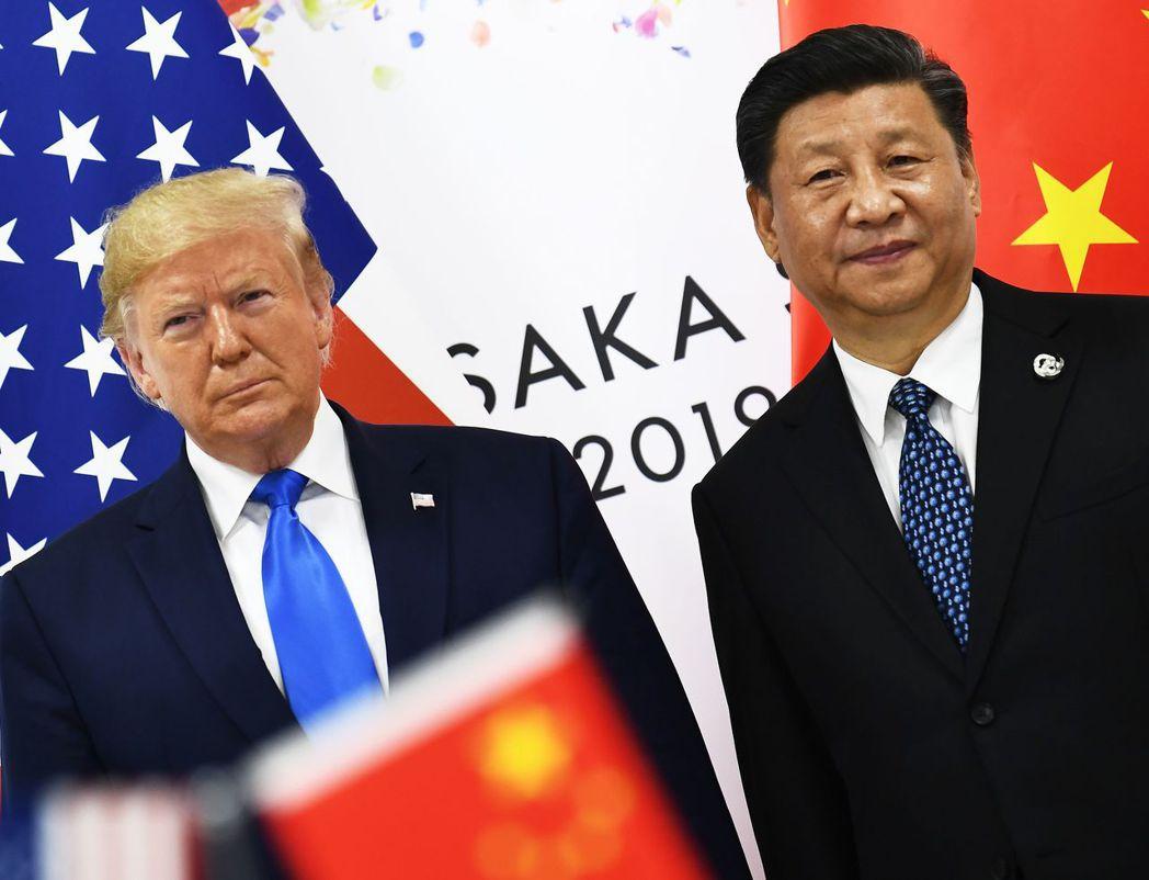 美中兩國將於15日簽署首階段貿易協議。圖為兩國領袖去年10月在大阪會晤情形。(法...