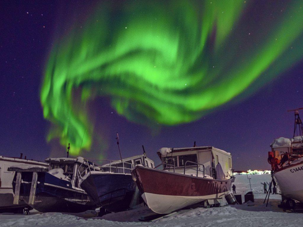 黃刀鎮極光宛如天空中舞動的綠色精靈。圖/有行旅提供