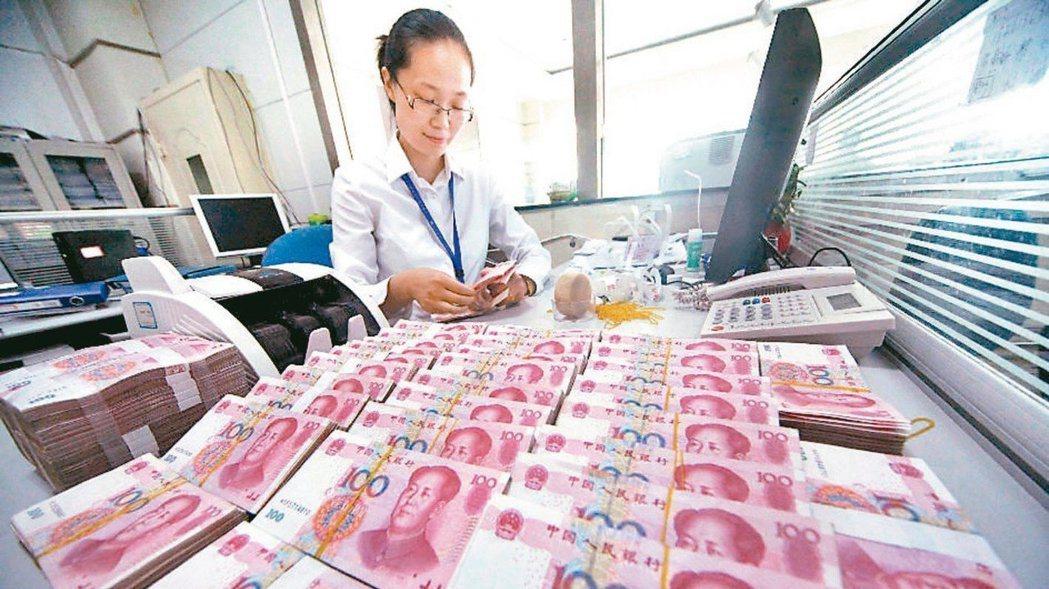 今年以來,人民幣對美元即期匯率累計升值1.4%。 照片/本報系資料庫