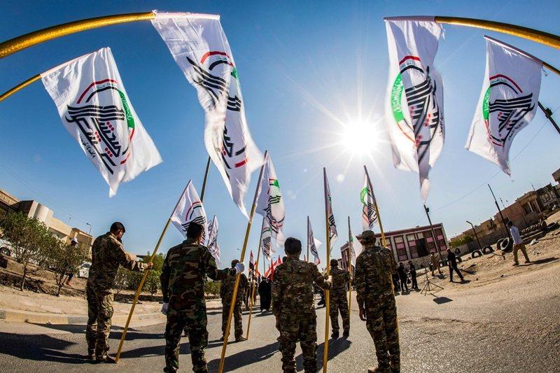 圖為蘇萊曼尼所屬的IRGC盟軍,親伊朗的伊拉克什葉派民兵「人民動員軍」。 圖/法新社