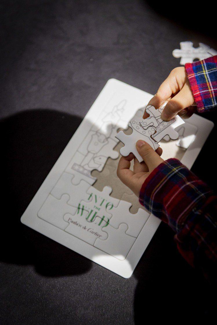 豹影迷蹤特展現場並提供簡易拼圖,訓練孩童手腦並用。圖╱Cartier提供。