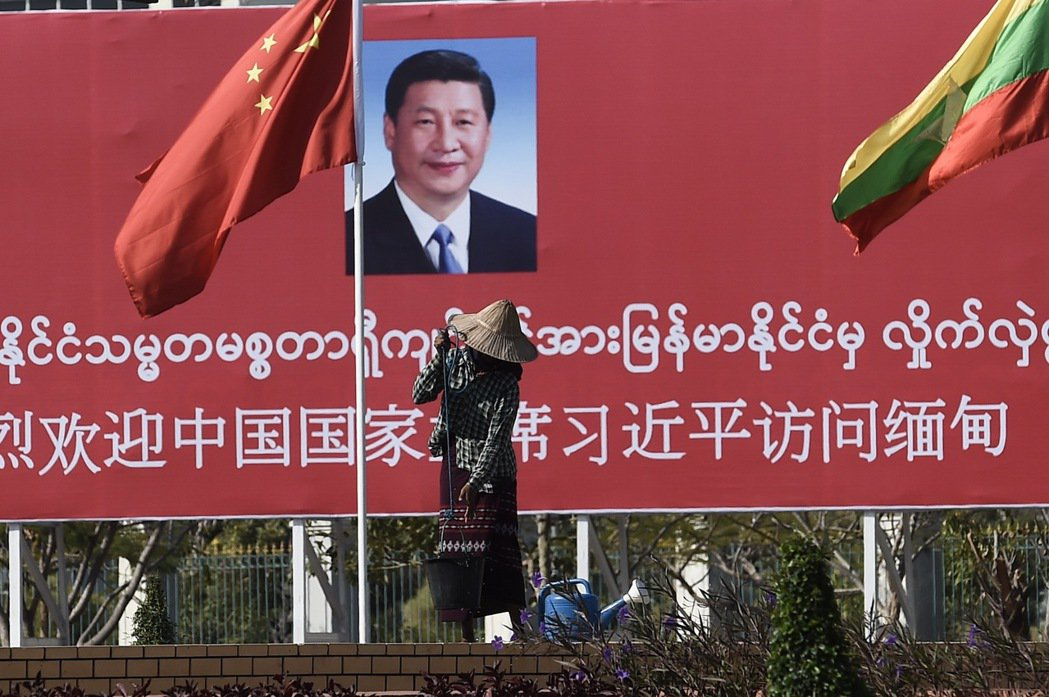 MYANMAR-CHINA-DIPLOMACY A woman waters g...