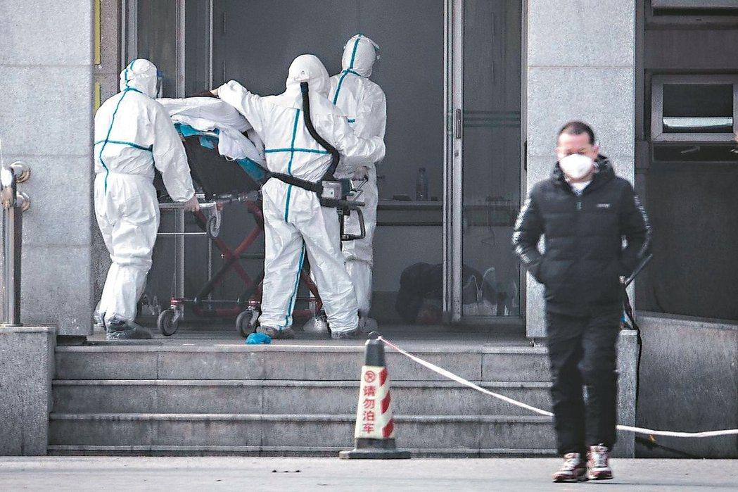 新型冠狀病毒感染的肺炎病例集中在湖北武漢市金銀潭醫院接受治療。法新社